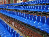 pic of tribunal  - The row of blue seats of tribunes