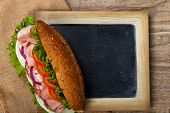 foto of deli  - Deli sub Sandwich with chalkboard - JPG