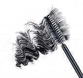 pic of superimpose  - smear of black brush mascara and false eyelashes isolated on white background - JPG