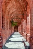 picture of arcade  - Old narrow brick arcade in town of Pollenzo in Piedmont - JPG