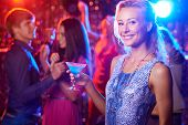 pic of posh  - Beautiful girl with cocktail looking at camera at party - JPG