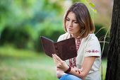 stock photo of palm-reading  - Young attractive woman reading e - JPG
