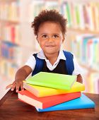 picture of clever  - Little clever preschooler in the library - JPG