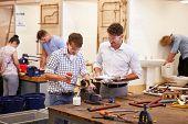 stock photo of plumbing  - Teacher Helping College Students Studying Plumbing - JPG