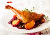 picture of roast duck  - Roasted duck leg with red cabbage and apples for Christmas - JPG
