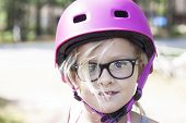 Постер, плакат: Child With Pink Bicycle Helmet And Black Glasses