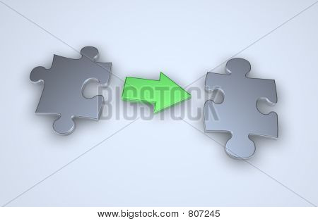 Picture or Photo of Puzzle pieces with arrow in between