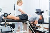 foto of physical therapist  - Patient at the physiotherapy doing physical exercises with therapist with sport doctor - JPG
