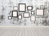 foto of wall painting  - 3D Rendering of Group of empty simple rectangular picture frames in different sizes hanging on a wall with an abstract mottled grey pattern conceptual of a gallery - JPG