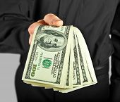 stock photo of holding money  - man holding money in hands dollar usa - JPG
