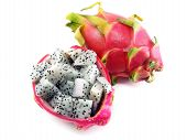 picture of dragon fruit  - Diced dragon fruit sliced in the shell next to a whole fruit - JPG