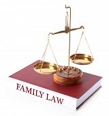 stock photo of punishment  - Scale on FAMILY LAW book isolated on white - JPG