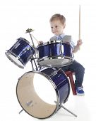 stock photo of drum-set  - An adorable preschooler playing on a drum set - JPG