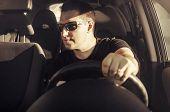 image of driver  - Car driver drive his car in black sunglasses - JPG