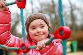 stock photo of playgroup  - Portrait of beautiful girl on the playground - JPG