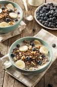 stock photo of quinoa  - Organic Breakfast Quinoa with Nuts Milk and Berries - JPG