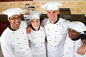stock photo of catering service  - group of professional chefs in commercial kitchen - JPG