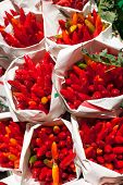 picture of red hot chilli peppers  - Packed red hot chilli peppers on a local market - JPG