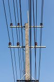 image of electricity  - an electricity pole with different electricity cables - JPG