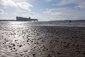 image of tide  - Weston-super-Mare beach at low tide with pier in distance