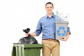 stock photo of recycle bin  - Man holding a recycle bin by a trash can isolated on white background - JPG