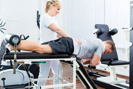 stock photo of therapist  - Patient at the physiotherapy doing physical exercises with therapist with sport doctor - JPG