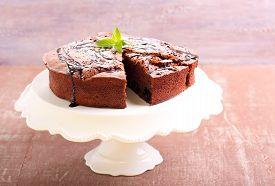 stock photo of torte  - Prune and chocolate torte on plate - JPG