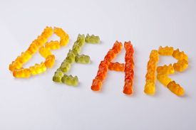 stock photo of gummy bear  - Letters made with colorful gummy bears making the word bear - JPG