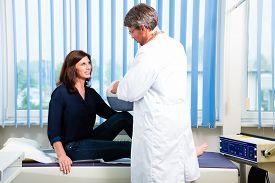 stock photo of ultrasonic  - Orthopedist doctor making ultrasonic image on patient in surgery - JPG