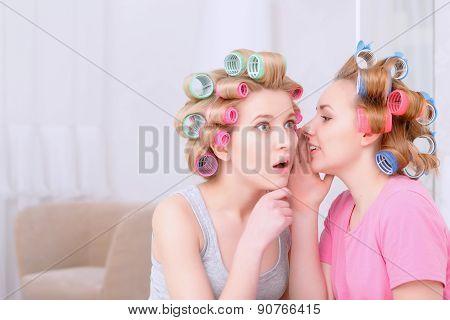 Young girls sharing secrets