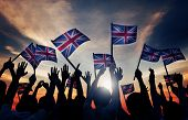 image of waving  - Group of People Waving UK Flags in Back Lit - JPG