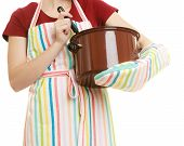 image of apron  - Happy housewife or chef in colorful kitchen apron with pot of soup and ladle isolated studio shot - JPG