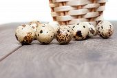 stock photo of quail egg  - quail eggs and a basket on the wooden table - JPG