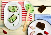 stock photo of canapes  - canape with cottage cheese greens and a garden radish - JPG