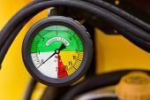 stock photo of vacuum pump  - Close up of colorful manometer on agricultural machinery - JPG