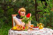 stock photo of curvaceous  - Beautiful Russian girl with a curvaceous rosy and happy sitting at a table with treats  - JPG
