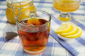 picture of tea bag  - Cup of tea with a jar of honey and lemon slices on the table - JPG