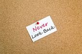 image of saying sorry  - Sticky Note On Cork Board Background Never look back concept - JPG