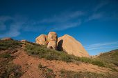 picture of wilder  - Rock boulders of stone emerge from a hillside in the wilderness of southern California - JPG