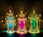 foto of occasion  - Set of Elegant Ramadan Kareem Lantern or Fanous in Gold With Colorful Lights in Blurred Golden Background for the Holy Month Occasion of fasting - JPG
