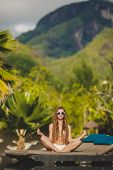 stock photo of infinity pool  - Young beautiful brunette with long straight hair - JPG