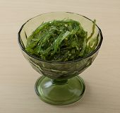 stock photo of sesame seed  - Chuka salad with sesame seeds on the wood background - JPG