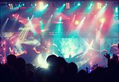stock photo of cheers  - Cheering crowd in front of bright colorful stage lights  - JPG