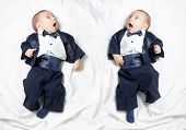 picture of scared baby  - Mirrored photo of cute infant baby boy wearing elegant tuxedo with bow tie - JPG