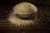 stock photo of sesame seed  - Organic natural sesame seeds against wooden background - JPG