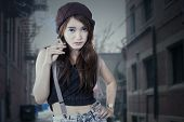 stock photo of teen smoking  - Portrait of beautiful adolescent girl standing at alley while smoking - JPG