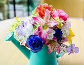 foto of vase flowers  - Artificial flowers in ceramic vase on the table - JPG