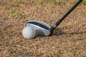 foto of disadvantage  - Drive golf on dead grass in the afternoon have sunlight on playing  - JPG
