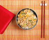stock photo of noodles  - Vietnamese vermicelli chicken and rice noodles soup pho served on a bamboo place mat - JPG