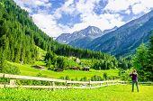 Постер, плакат: Photographer and alpine landscape in Alps Austria